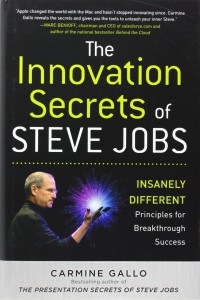 Book cover with Steve Jobs holding a holographic multicolored light burst in his hand