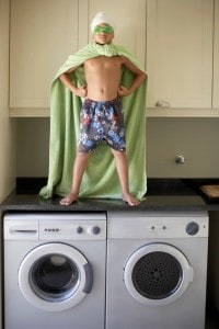 Both standing onto of a washing machine who is wearing a cape and goggles like a superhero to depict the value of knowing our strengths and weaknesses