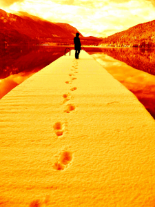March forth footprints in snow, which is golden toned.