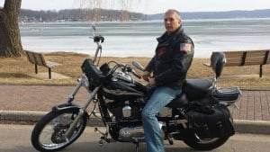 Tradition of my husband riding his motorcycle with ice of Lake Geneva in the background.