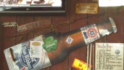 the tradition and bars for fishermen is honored on this bar's wall with the harpoon