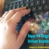 "Maggie's hand typing a keyboard with fireworks and ""Happy 4th Blogging Anniversary Brilliant Breakthroughs Inc!"""