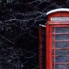 A British Telephone Booth is a slightly snow covered country scene depicts team management requiring open communicaion