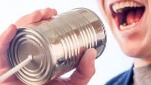 Networking Tips depicted by a man shouting into t tin can with a string ties to it.