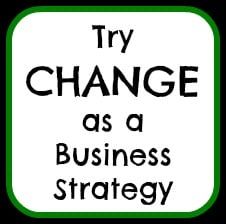 """Focusing on goals depicted with hand written message """"Try CHANGE as a Business Strategy"""""""