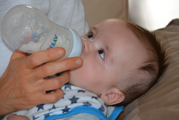 Sales feed a business. Just as in this photo of a parent feeding a baby with a bottle.