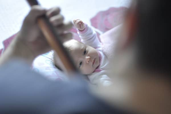Pushover Business Owner depicted by Dad playing guitar to his a baby.
