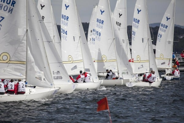 Staying on course to efficiently get to your destination depicted by sailboats lined up to start a race.