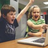 Success and Failure: depicted by two children playing a video game and cheering because they won!