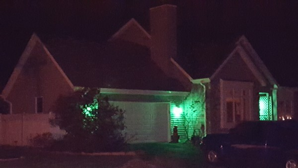 Actively Showing Appreciation illustrated by a home with Green lights to support the Greenlight a Vet Night advocacy program.