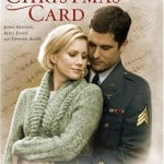This movie poster for The Christmas Card movie poster is illustrated with a uniformed soldier tenderly hugging a women as she begins to turn to him.