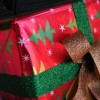 Business Owners Surviving Christmas tip illustrated as a Christmas gift wrapped in Christmas tree paper and glittering green and golden bows.