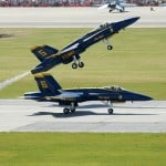 Workplace awesomeness illustrated by the Air Force's Blue Angels team performing aerial stunts.