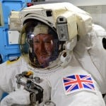 YOUR Business Purpose illustrated through the precision of preparing for a Galactic Spacewalk at the International Space Station. Image of European Astronaut from Britain wearing his space suit while still inside the station.