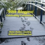 Consistency illustrated by a snow covered bridge in a wooded area that has paths of footprints in the snow.