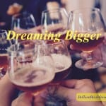 Dreaming Bigger for business success illustrated by people holding up brandy glasses for a celebratory toast