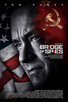 Bridges of Spies Movies poster illustrated with Tom Hanks face (as the negotiator) positioned with a large American flag behind him and a small Russian flag of to his side.