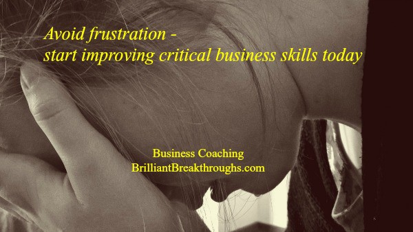 Improving critical skills in business illustrated by a frustrated women, who is holding her face in her hand. The image is a black and white and a close up.