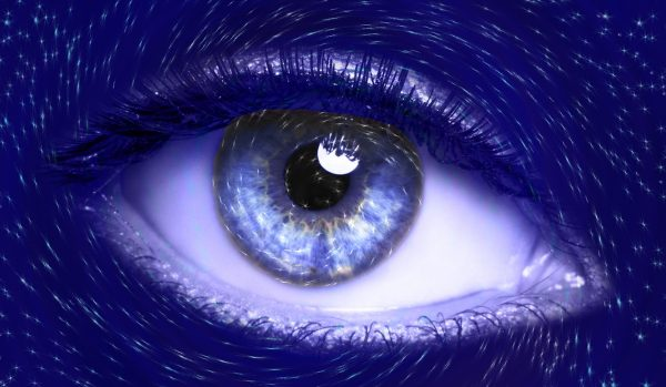 Become the living vision of YOUR Business illustrated with a close up image of a a female's blue eye and her painted blue skin