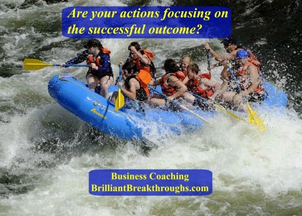 Your Actions illustrated by a group of people in a white water raft in rough waters all having to make their actions align with the mission.