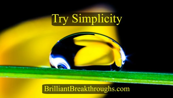 Try Simplicity illustrated as a rain drop rolling along a blad of grass while reflecting a flower from behind it.