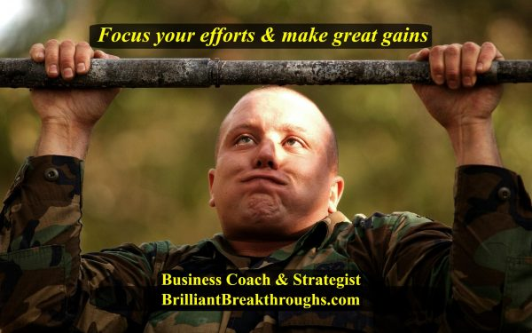 Focus your efforts illustrated by a soldier going crossed-eyed with concentration as he tries to do one more pull-up while he's holding his breath.