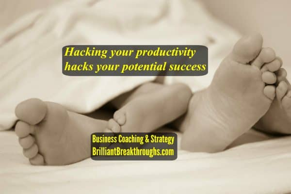 Hacking your productivity illustrated by a couple's feet in bed with the bed being short-sheeted.