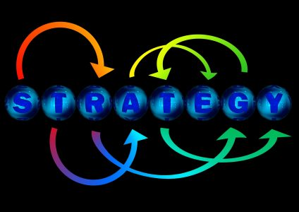 2016 third quarter strategy illustrated with the letters of strategy in blue pool balls with neon colored arrows pointing to all different letters.