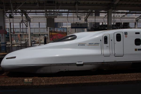 Learning from Subject Matter Experts illustrated bu an image of a Japanese bullet train that is in station.