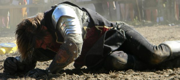 Business Owners struggling to improve illustrated by a knight trying to get up off the ground.