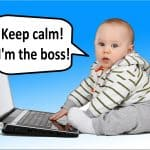 Business Coaching by Brilliant Breakthroughs, Inc. _YOUR Boss is a Jerk illustrated by a baby in front of a laptop claiming he's the boss.