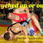 Psyched up illustrated with wrestlers in pinning pose at high school match.
