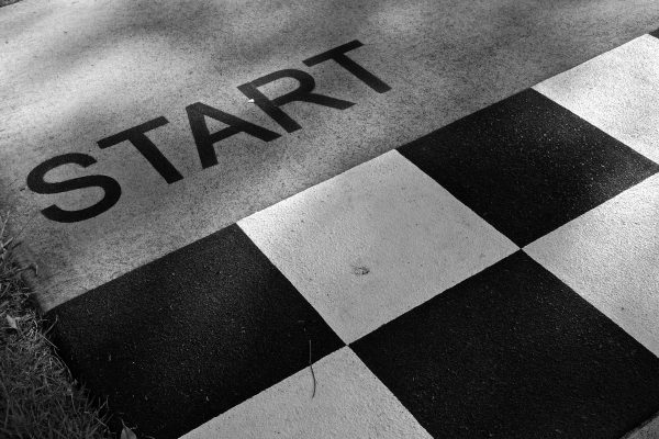 Business Coaching: Proper Preparation by Brilliant Breakthroughs, Inc. illustrated with a black and white checkered Starting Line.
