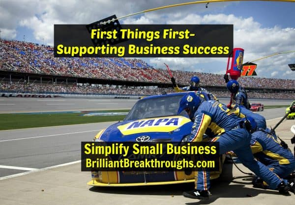 Small Business Coaching by Brilliant Breakthroughs, Inc. First Things First illustrated by a pit crew changing tires in a NASCAR Race.