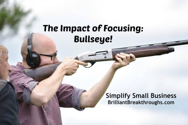 Small Business Coaching by Brilliant Breakthroughs, Inc. Focusing on 5 technique illustrated by a man seriously focusing as he aims to hit his bullseye with a shotgun.