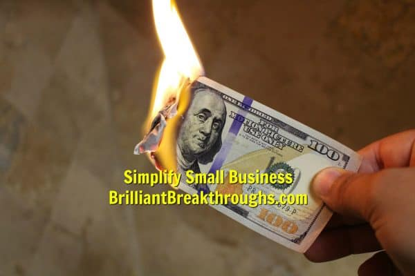 Small Business Coaching by Brilliant Breakthroughs, Inc. Business Power Moves illustrated by a $100 bill burning.