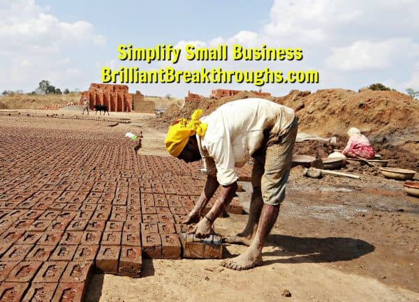 Small Business Coaching by Brilliant Breakthroughs, Inc. Proper Preparation illustrated by man laying brick foundation for building.