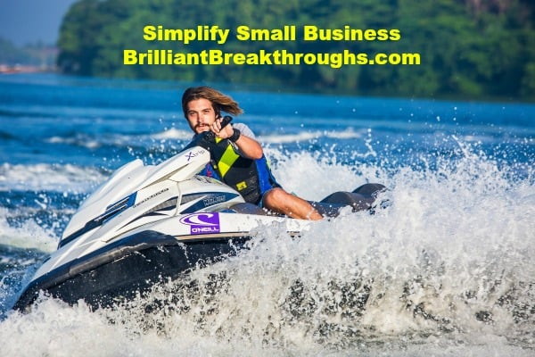 Small Business Coaching By Brilliant Breakthroughs, Inc. Balancing Summertime Play and Work illustrated by young man riding jet ski on lake.