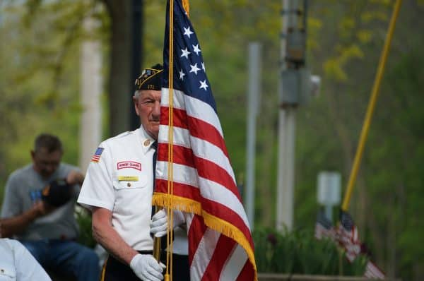 Small Business Coaching by Brilliant Breakthroughs, Inc.  Memorial Day honored with veteran color guard marching with American Flag.