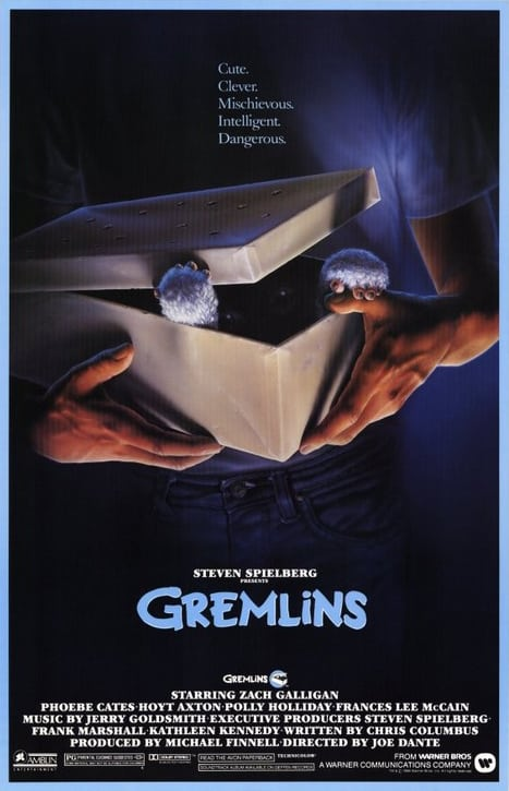 Gremlins movie poster with boy opening his gift.