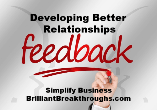 Two faces in background with the word feedback in the middle to help develop better relationships