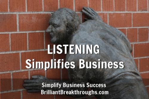Statue man listening to a brick wall.
