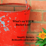 Red painted bucket full of water.