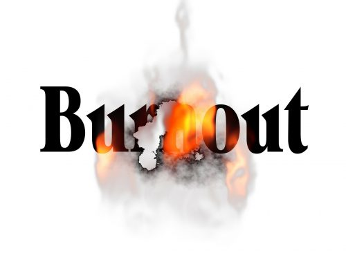 The word Burnout with flames and smoke coming through it.
