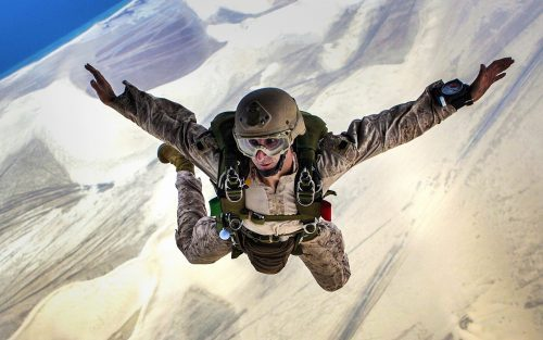 Jumping into Action in full military jumping gear