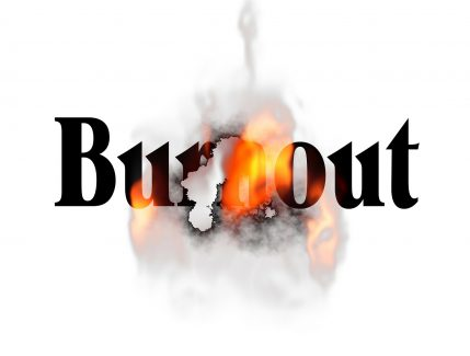 burnout image of words with flames and smoke representing overworked and exhausted